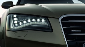 LED automotive application of daylight running lights in headlight cluster for Audi A8.
