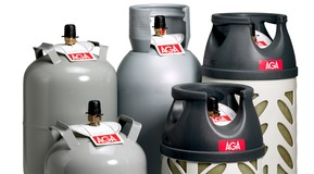 Five propane cylinders for home use in Norway. Three steel cylinders and two composite. For all kinds of printed matters.